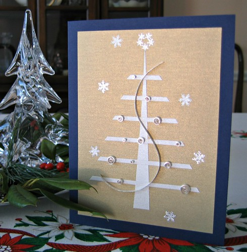 Quilled Christmas tree card on decorated table
