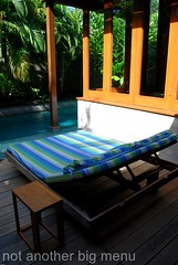 The Elysian, Bali - Deck chair by the pool