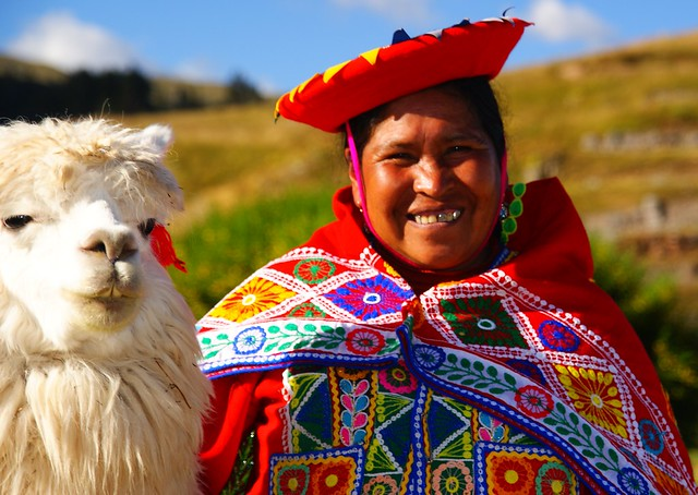 The lady and the llama in Cuzco, photo by flickr user NomadicSamuel