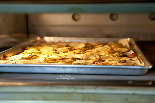 Thin potato slices roasting in the oven