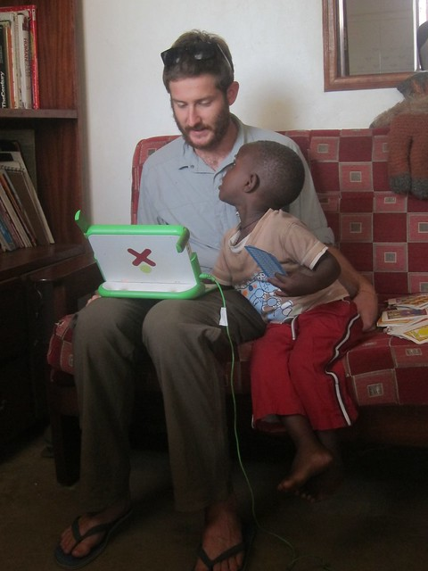 Nick and Prosper with an OLPC