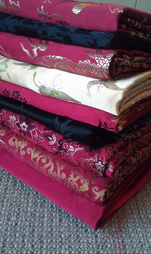 silk brocades: reds stacked