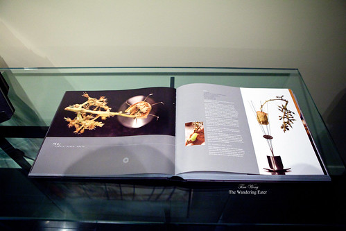 Open book of Alinea's cookbook