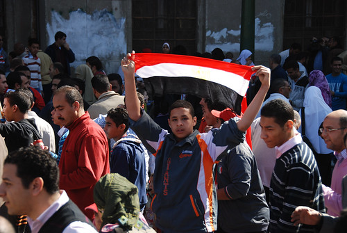 A young Egyptian holding a flag