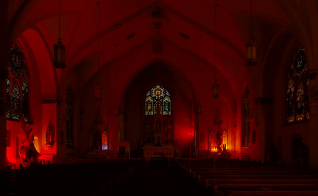 Saint Mary Roman Catholic Church, in Glasgow, Missouri, USA - interior by candlelight