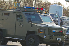 armored car, automobile, automotive exterior, law enforcement, vehicle, armored car, emergency vehicle, bumper, motor vehicle,