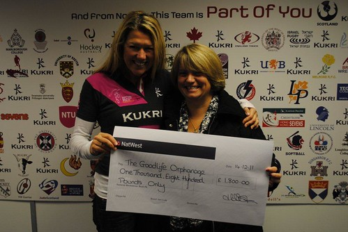 Woody presents the cheque to Mary