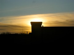 daybreak, with a crooked chimney