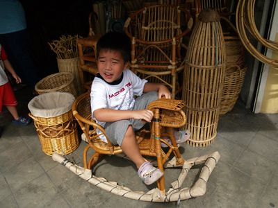 Julian on rattan rocking horse