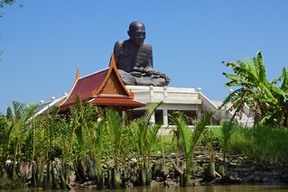Huge statue of a famous monk overlooking the Mae Klong river in Amphawa, Samut Songkhram, Thailand