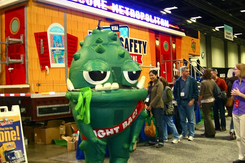 "BAC!®, the Discovery Zone's ""green bacteria"" mascot greets Metropolitan Cooking and Entertaining Show attendees as they line up to tour the interactive and educational Food Safety Discovery Zone."