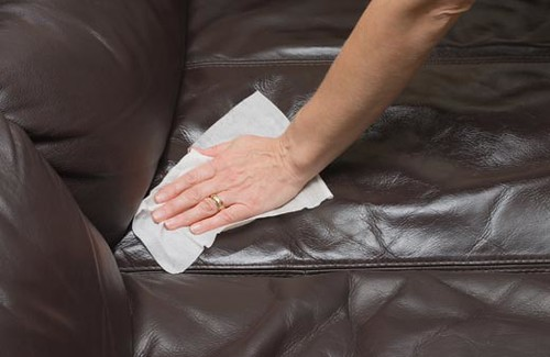 Picture of a leather sofa being cleaned