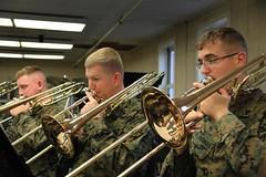 string instrument(0.0), tuba(0.0), orchestra(0.0), musician(1.0), trumpet(1.0), trombone(1.0), musical ensemble(1.0), music(1.0), brass instrument(1.0), wind instrument(1.0),