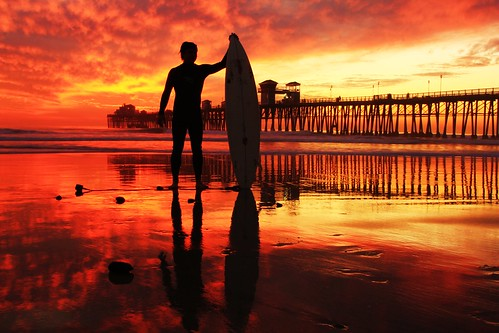 california sunset vacation silhouette surfer socal cloudporn oceansidepier firesky wetreflection gettysimages