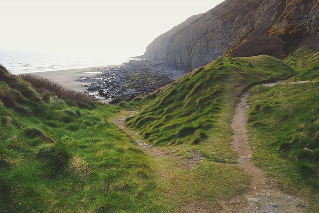 Grassy hills along the Pendine Sands shoreline.