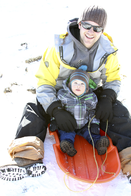 jc and daddy on the sled