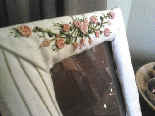 Embroidered fabric covered frame