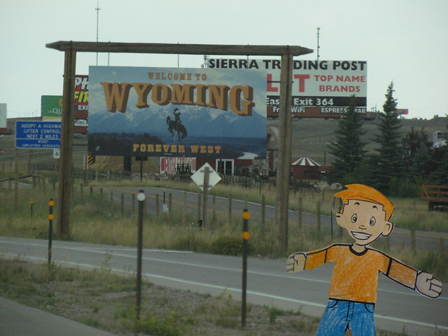 Stan with Wyoming State Sign