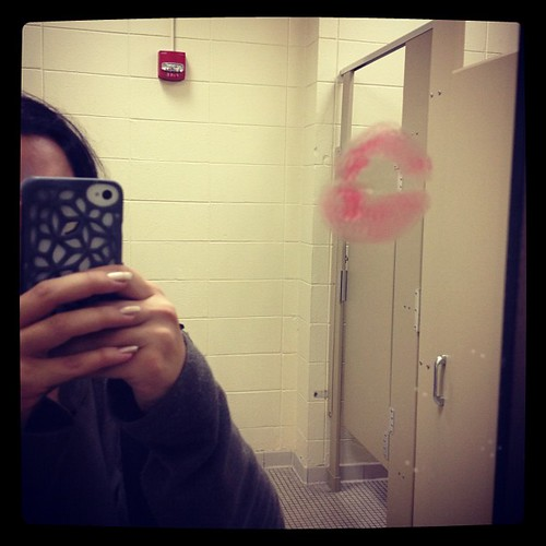 Who kisses mirrors in pubic restrooms? Gross.