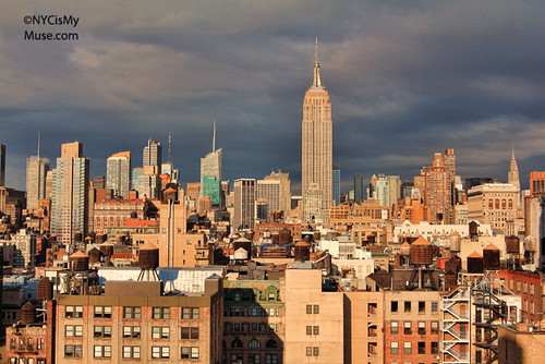 Empire State Building and the wild afternoon skies: bright sun through gray skies