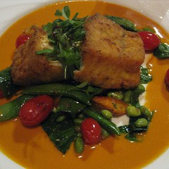 maize-crusted corvina with vegetables of the moment and tomato-butter sauce
