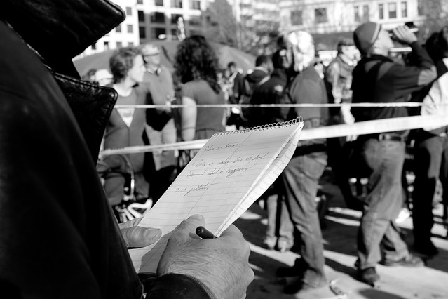 reporter at OccupyDC rally