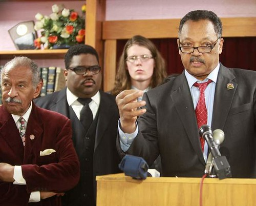 Detroit press conference featuring Rev. Jesse Jackson at microphone, Cong. John Conyers and Rev. Charles Williams II. They are opposing the imposition of an emergency manager in the city. by Pan-African News Wire File Photos
