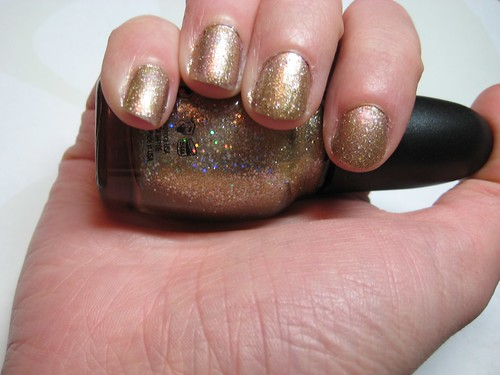 sephora by opi - looks like rain dear gold glitter nail polish