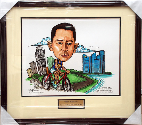 cyclist caricature for Ang & Partners with metal engraving in frame