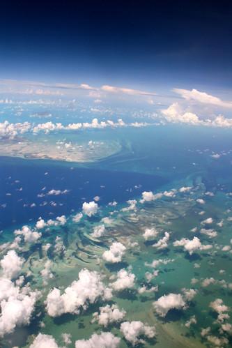 ocean blue shadow clouds island flying caribbean