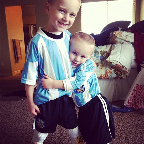 Dad brought them soccer uni's from argentina. I guess they are ready to play futbol