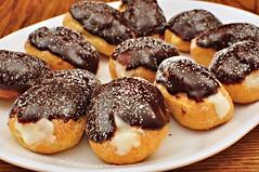 doughnut(0.0), sufganiyah(0.0), poffertjes(0.0), danish pastry(0.0), pastry(1.0), baking(1.0), petit four(1.0), baked goods(1.0), profiterole(1.0), food(1.0), dish(1.0), dessert(1.0), pä…czki(1.0), cuisine(1.0), snack food(1.0),