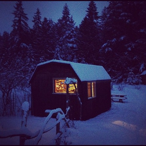 Cabin at dusk in the snow