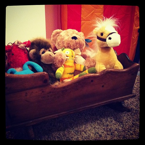 Some of harry's stuffies in my childhood doll cradle. #operationplayroom