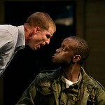 Billy (Brad Fleischer) confronts Carlysle (Ato Essendoh) in the Huntington Theatre Company's production of Streamers, directed by Scott Ellis, playing at the BU  Theatre, part of the 2007-2008 season. Photo: T. Charles Erickson.