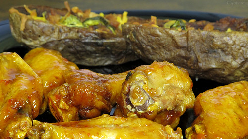 Sweet chili wings and stuffed potato skins