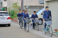Students cycling Kyoto