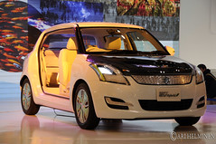 hatchback(0.0), automobile(1.0), wheel(1.0), vehicle(1.0), automotive design(1.0), suzuki swift(1.0), auto show(1.0), city car(1.0), compact car(1.0), land vehicle(1.0),