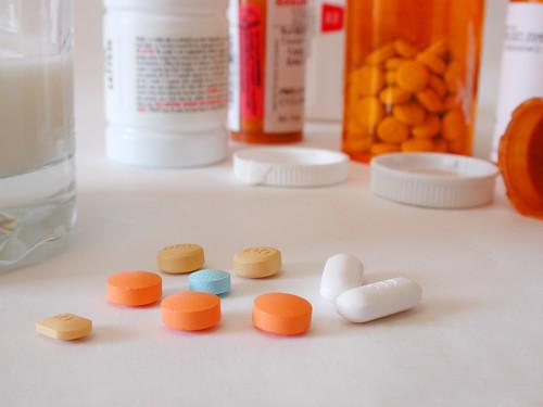 taking prescription pill with milk