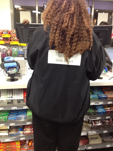 "I wonder if she knew she had a sticker that said ""Shoddy Izod Jacket"" on her back"