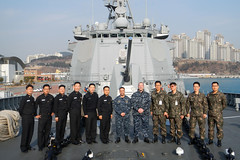 BUSAN, Republic of Korea (Jan. 29, 2012) Chief Warrant Officer Rene Cornejo, assigned to USS Cowpens (CG 63), and Operations Specialist 1st Class Lucas Weaver of USS Shiloh (CG 67), pose on the forecastle of ROKS Sejong the Great (DDG 991) with Republic of Korea navy sailors in between Air Intercept Control (AIC) training sessions. (U.S. Navy photo by Lt. Cmdr. Marvin Park)