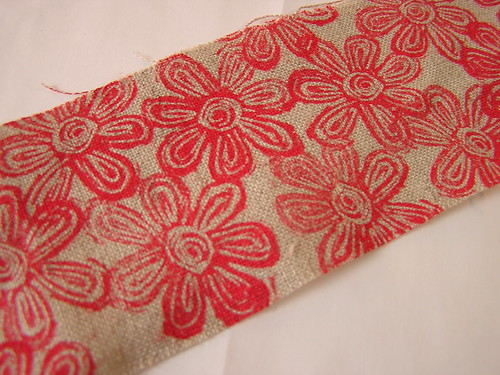 red flowers stamped on linen with paint