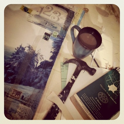 Maps, scraps, hammer, coffee.