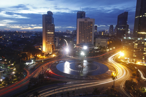 City and traffic lights at sunset in Jakarta