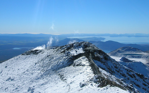 Steam emitted from the peak of Ngauruhoe, New Zealand. Lake Taupo, a large caldera, can be seen in the background.