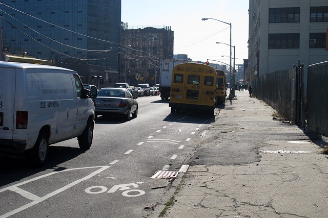 buses parked in bike lane outside Dept of Education