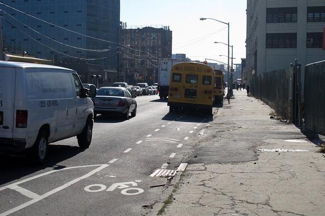 buses parked in bike lane outside Dept of Education