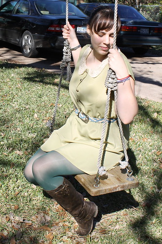 Longhorn outfit: thrifted belt, urban outfitters dress with lace peter pan collar, green tights, leather boots, wooden board swing