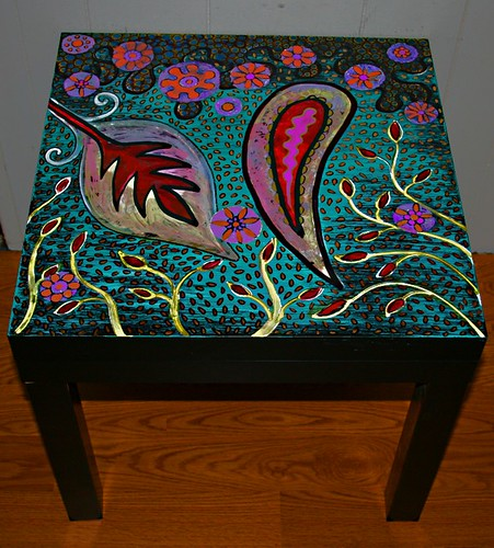 Funky home decor paisley garden table for Funky garden accessories