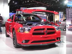 automobile, automotive exterior, exhibition, dodge, vehicle, stock car racing, automotive design, auto show, bumper, land vehicle, luxury vehicle, motor vehicle,